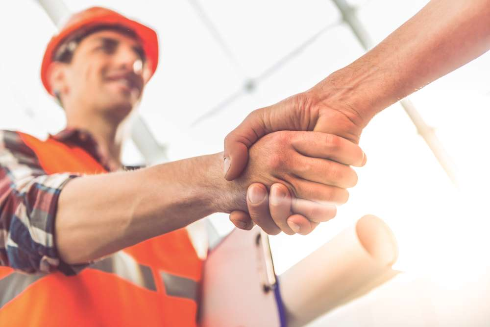 contractor shaking customers hand