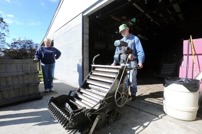 Bill and Ann Fox with an old-fashioned dry cranberry harvester at Fox's Cranberry Bog in Mullica Township, NJ, in 2011. Photo by Anthony Smedile.