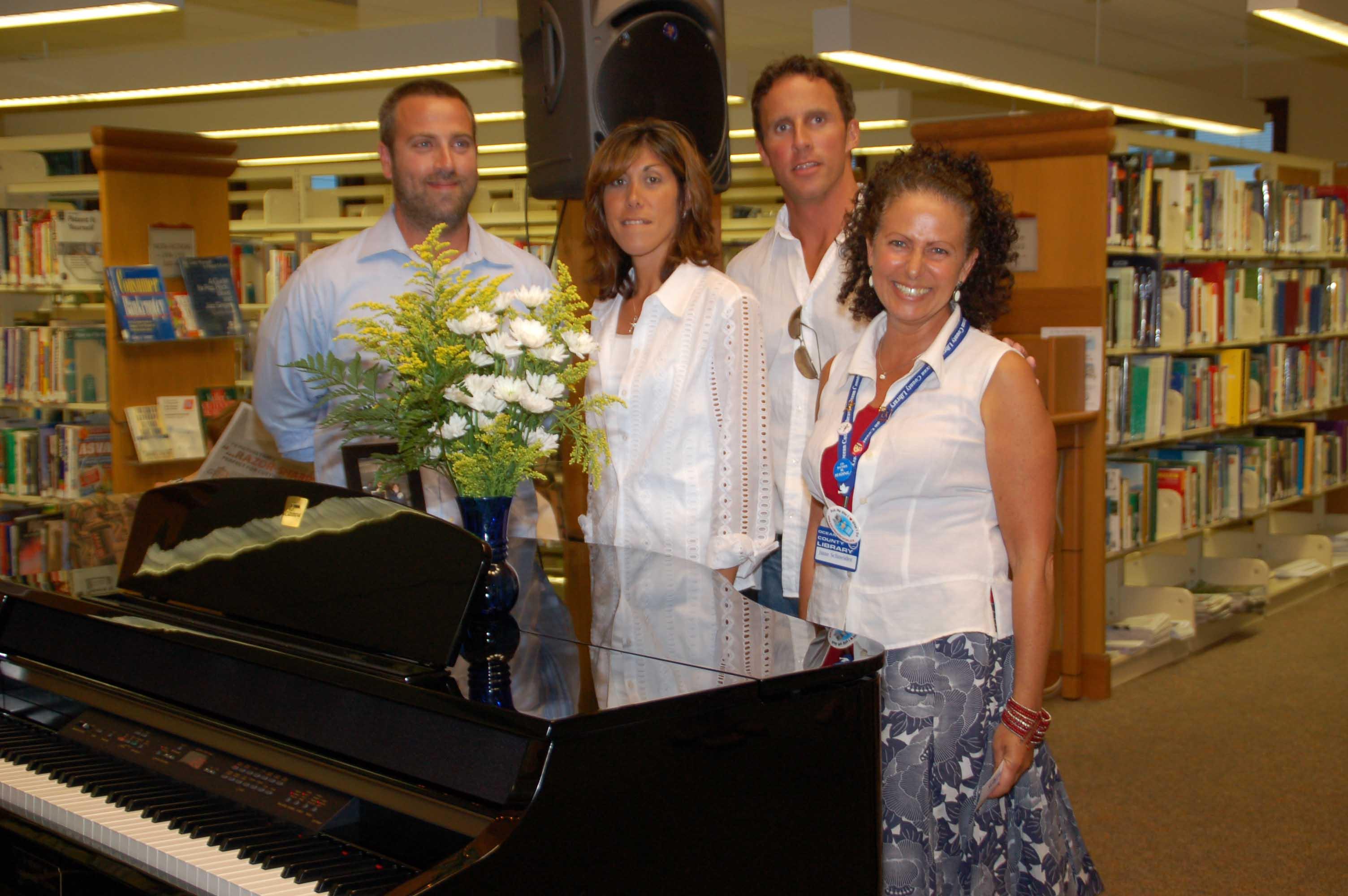 Mike Vizzone, Angela Fioretti, Paul Vizzone and June Schneider at the piano dedication