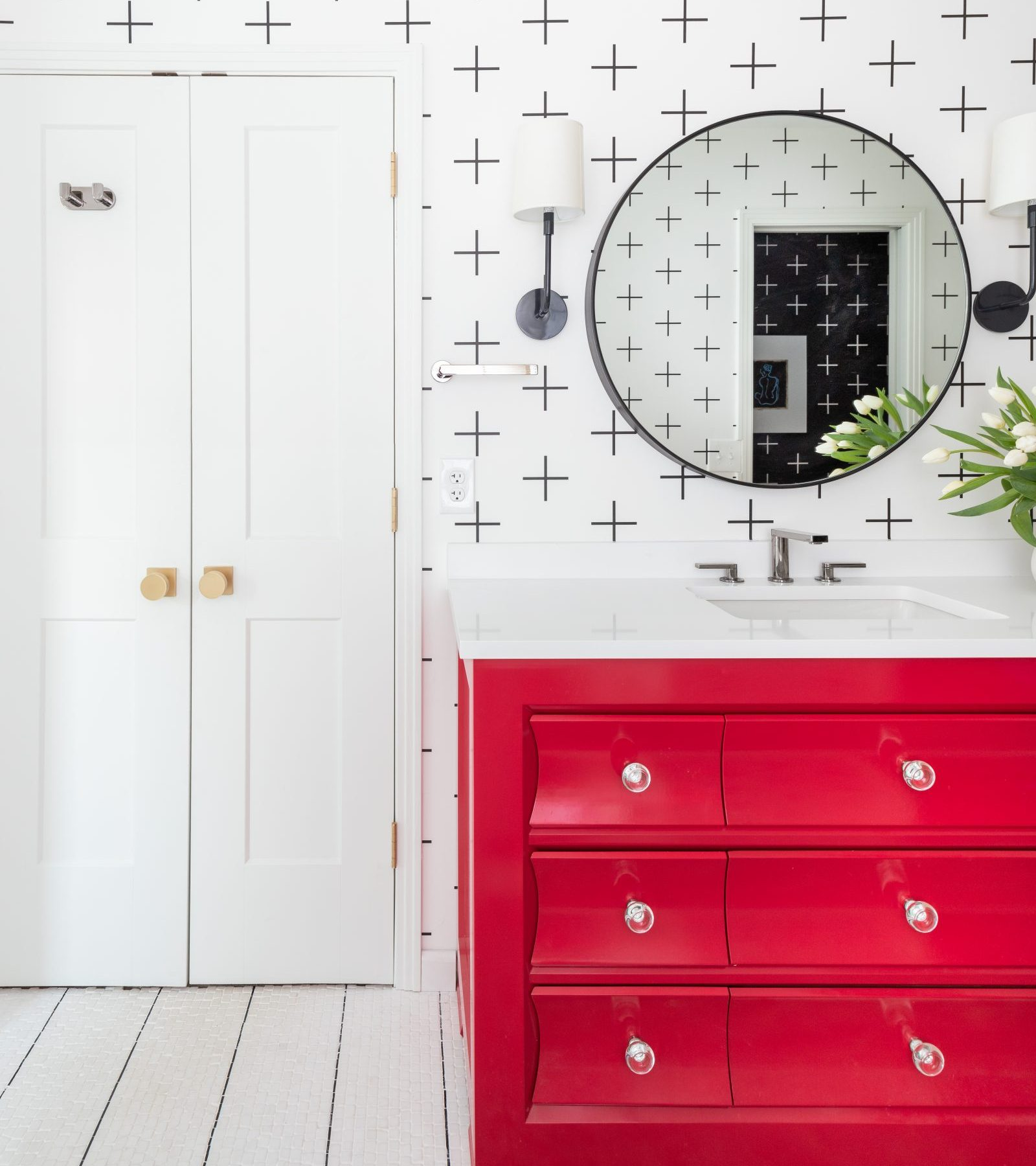 white bathroom with red vanity