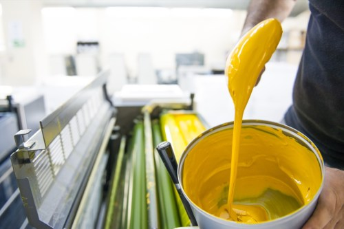 yellow paint dripping off brush into paint can paint shortage blog