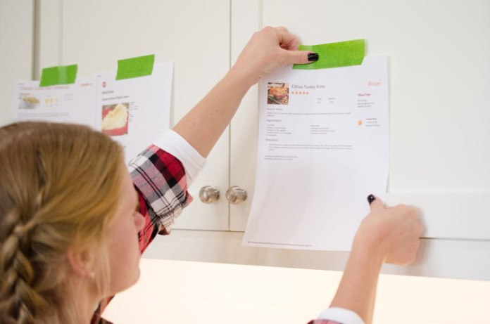 Print out recipes and tape them at eye level on kitchen cabinets.