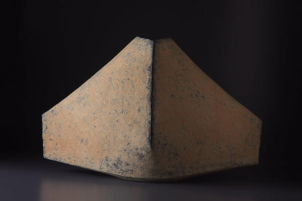 Multi-fired mountain shaped vessel, scored vertical line and surface colorations, peach and #11 blue tones<br /><br /><br /> 2007<br /><br /><br /> Stoneware<br /><br /><br /> 16 3/8 x 25 x 12 3/8 inches<br /><br /><br /> Inv# 5552