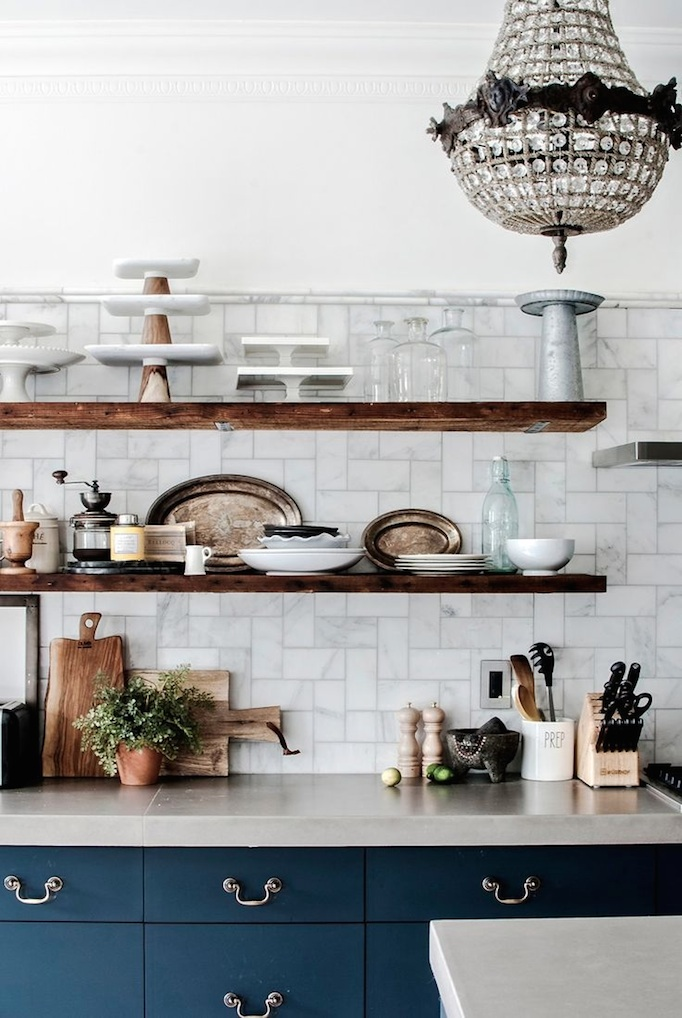 carerra marble and navy kitchen