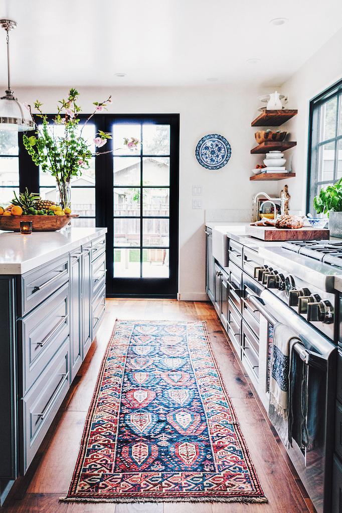 blue kitchen cabinetry antique rug