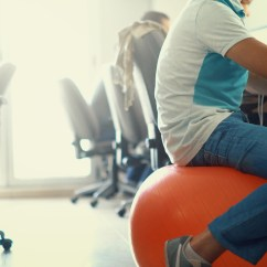Chair Exercises On Cable Tv Office Tall Thinking Of Sitting An Exercise Ball At Work Here S Why You Coach