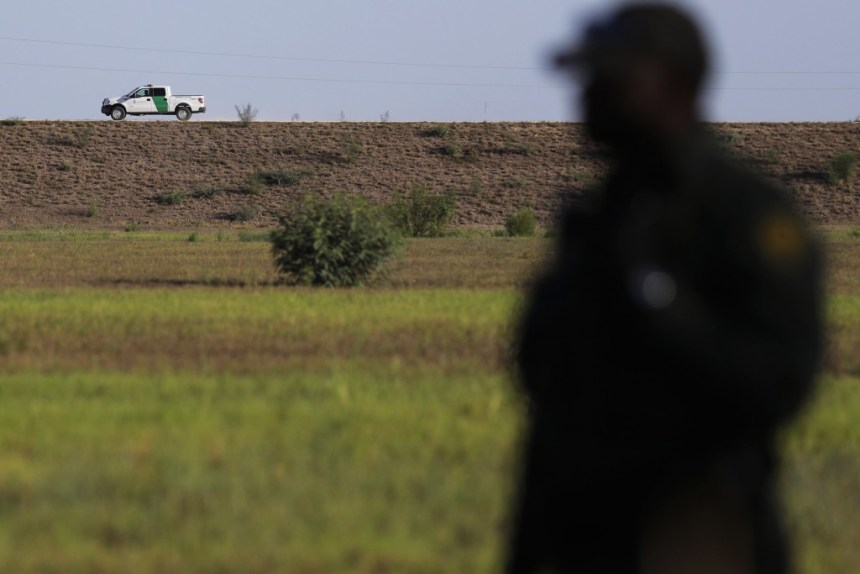 In this Aug. 11, 2017, photo, U.S. a Customs and Border Patrol vehicle patrols along a levee in Granjeno, Texas. Law enforcement officials in the Rio Grande Valley say a border wall is part of their strategy to slow the entry of drugs and illegal immigration. And they want to avoid the issues that stymied the U.S. government after the Secure Fence Act. That resulted in hundreds of lawsuits and years of delays in Texas, and yielded just 100 miles (160 kilometers) of fencing in the state. (AP Photo/Eric Gay)