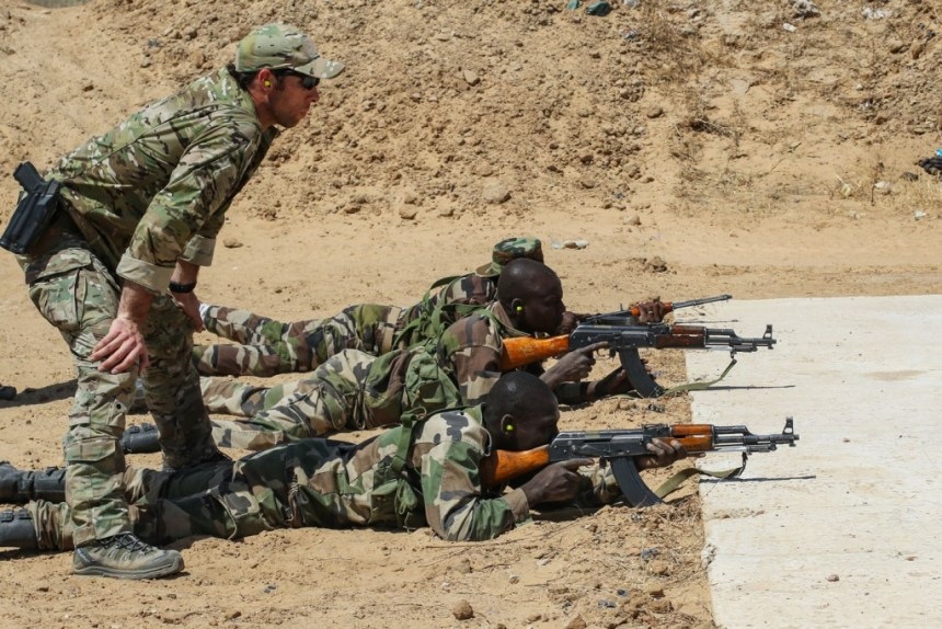 A U.S. Army Special Forces weapons sergeant observes a Niger Army soldier during marksmanship training as part of Exercise Flintlock 2017 in Diffa, Niger, Feb. 28, 2017. Niger was one of seven locations to host tactical-level training during the exercise while staff officers tested their planning abilities at a simulated multinational headquarters in N'Djamena, Chad. (U.S. Army photo by Sgt. 1st Class Christopher Klutts/released)