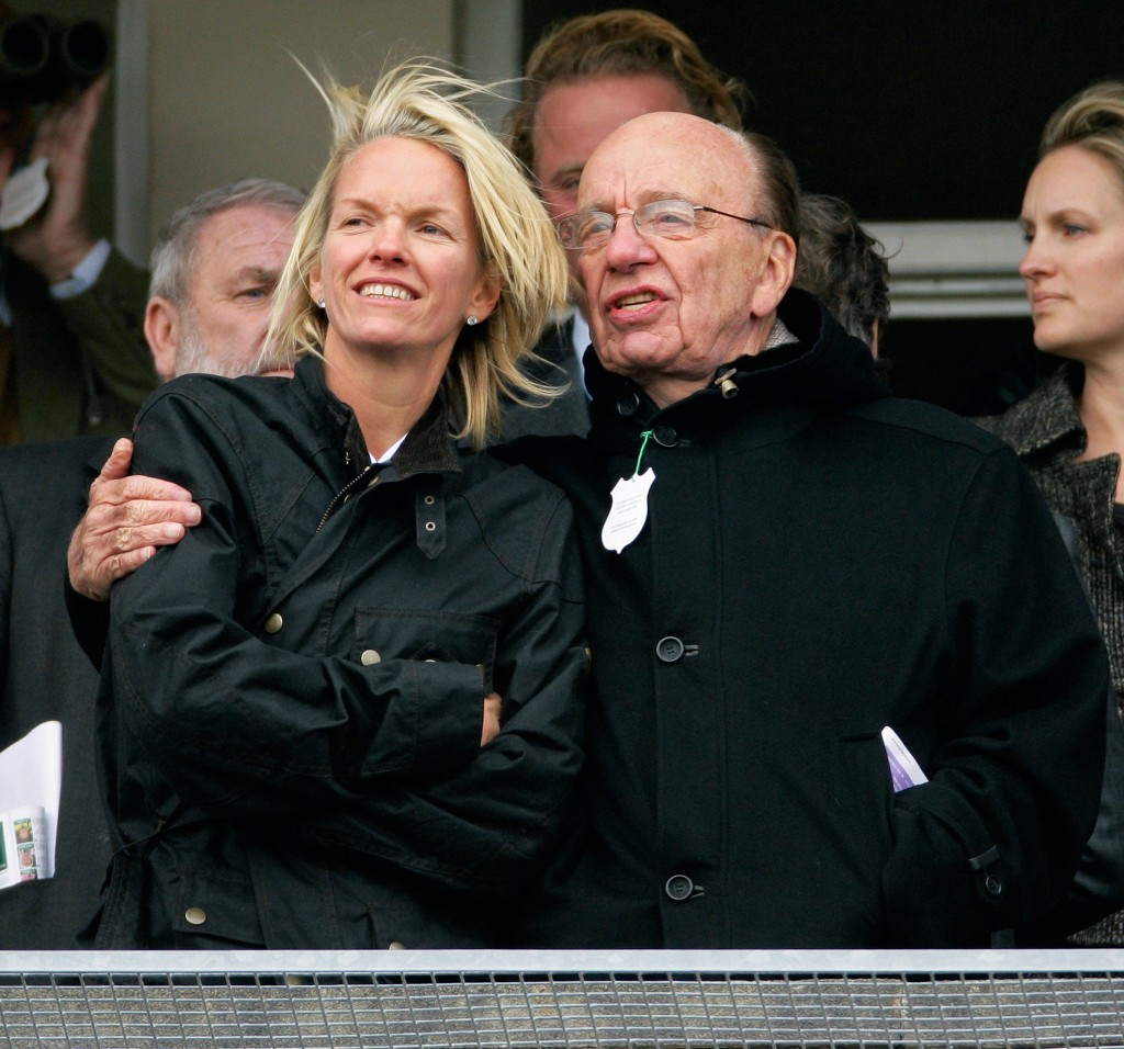 CHELTENHAM, UNITED KINGDOM - MARCH 18: (EMBARGOED FOR PUBLICATION IN UK NEWSPAPERS UNTIL 48 HOURS AFTER CREATE DATE AND TIME) Elisabeth Murdoch hugs her father Rupert Murdoch as they watch the racing on day 3 of the Cheltenham Horse Racing Festival on March 18, 2010 in Cheltenham, England. (Photo by Indigo/Getty Images)