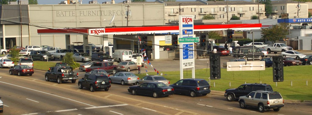 Vehicles form a line at an Exxon gas station off of Interstate 55 in Jackson, Miss., Tuesday, Aug. 30, 2005. The station was one of the few in the city with both power and gas one day after Hurricane Katrina made landfall. (AP Photo/The Calrion Ledger, Rick Guy)