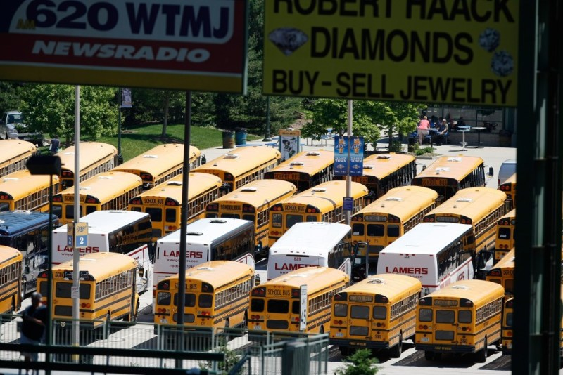 MILWAUKEE, WI - MAY 27: School buses are parked in a parking lot outside of Miller Park during the game between the Houston Astros against the Milwaukee Brewers at the Miller Park on May 27, 2010 in Milwaukee, Wisconsin. The Brewers defeated the Astros 4-3 in 10 innings. (AP Photo/Scott Boehm)