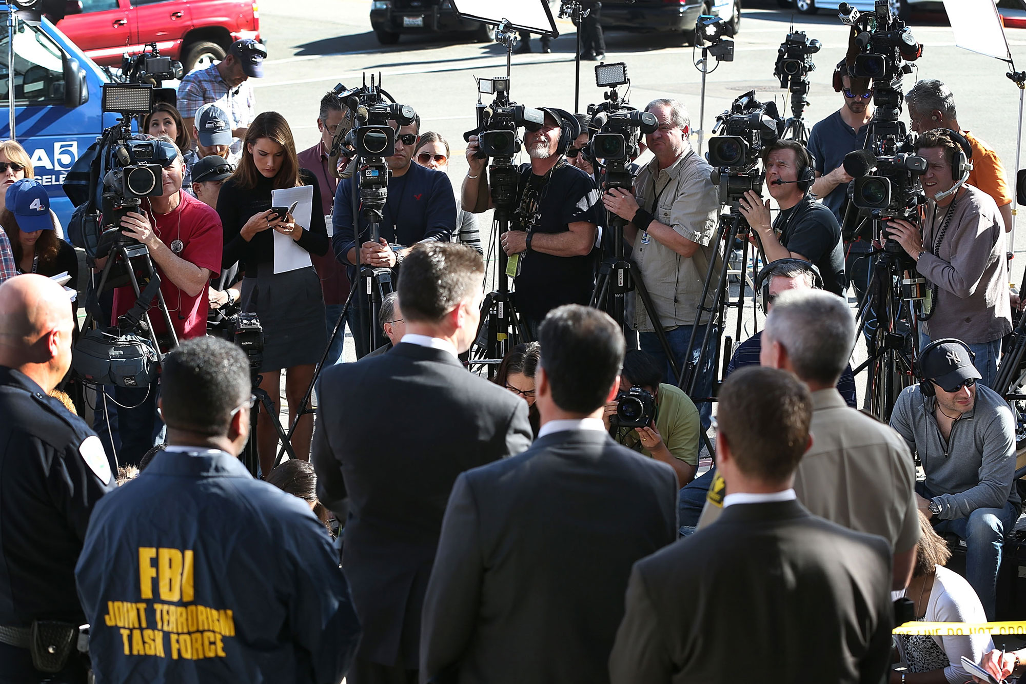 SAN BERNARDINO, CA - DECEMBER 07:  David Bowdich, FBI Assistant Director in Charge of the Los Angeles Field Office, (C) stands with other law enforcement officials as he speaks to the media about the terrorist attack at the Inland Regional Center on December 7, 2015 in San Bernardino, California. Law enforcement officials continue to investigate the mass shooting at the Inland Regional Center in San Bernardino that left 14 people dead and another 17 injured on December 2nd.  (Photo by Joe Raedle/Getty Images)