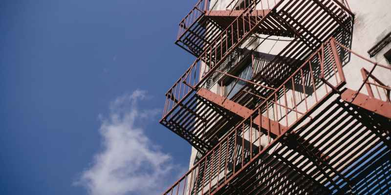 tall staircase with railings of concrete building