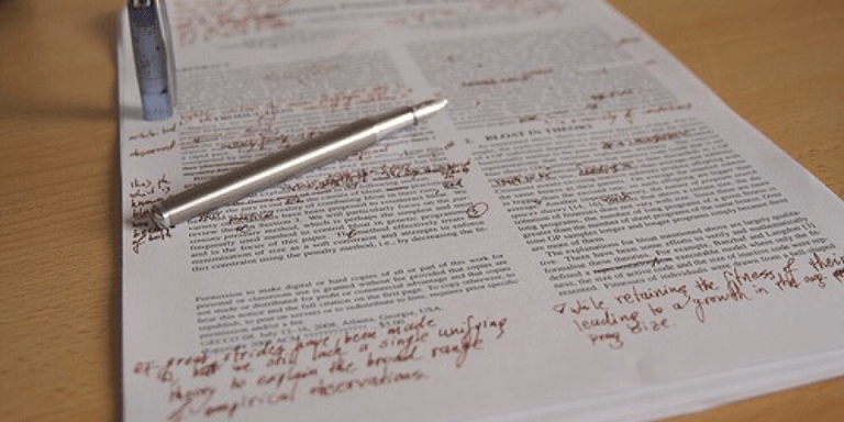 A paper covered in proofreading marks