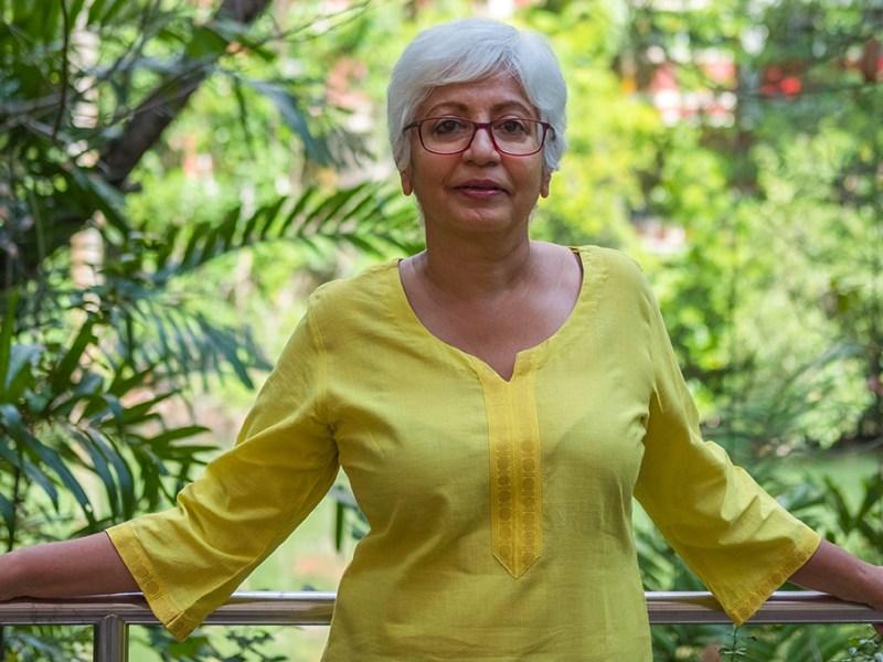 Older Asian female subject matter expert