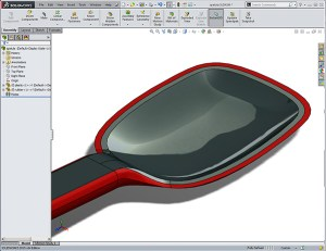 Pyrex Spatula created in a Design-engine Solidworks surfacing class shows example utilizing top down design to obtain co-injection softtouch