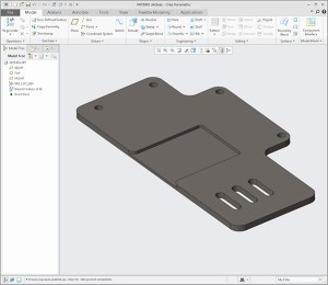 Using Creo we take this IGES aluminum plate and convert it to be parametric