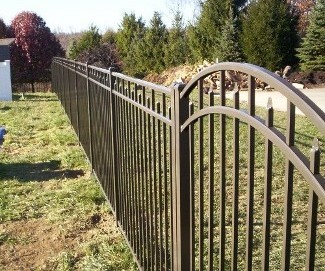 A four foot wide OnGuard Siskin style arched top gate. All gates produced by OnGuard are 'full width'; in other words, a 4 foot gate measures 48 inches so allowances have to be made for hardware (hinges and latch). Some other manufacturers sell a 4 foot gate that will fit in a 4 foot opening.