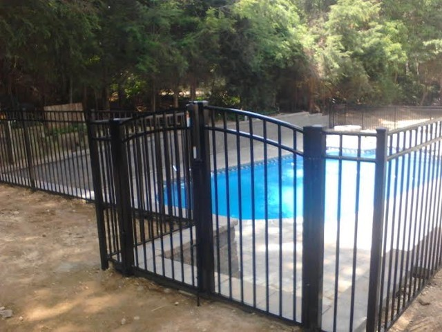 aluminum fence installation. a pool code compliant continuous dome arched top double gate in the onguard starling style shown aluminum fence installation