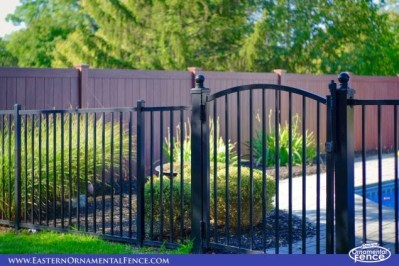 Eastern Ornamental Aluminum Style EO40V shown with a 4x4 Accent gate hung from available 4x4 posts with ball caps. Note the beautiful Grand Illusions Wood Grain privacy fence!
