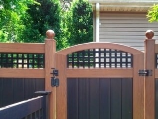 Rosewood and Black V3215SQ - Square lattice topped T&G privacy panels with matching crowned gate and ball caps on the posts.