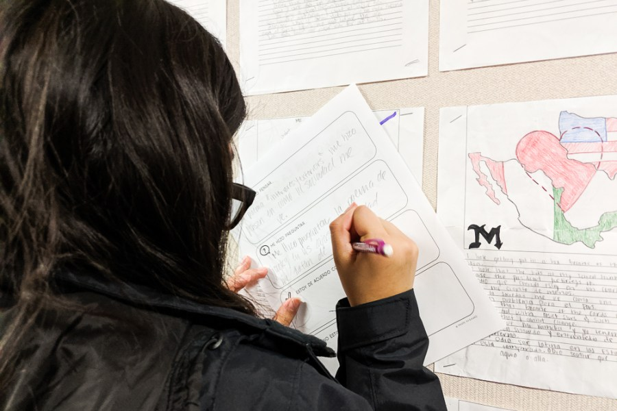 student filling out gallery walk sheet
