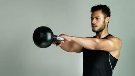 Man Performing Kettlebell Swing