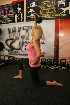 Woman Performing Kettlebell Lunge Press
