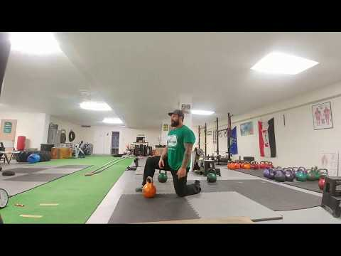 Kneeling Kettlebell Neat And Press Energy Exercise Session