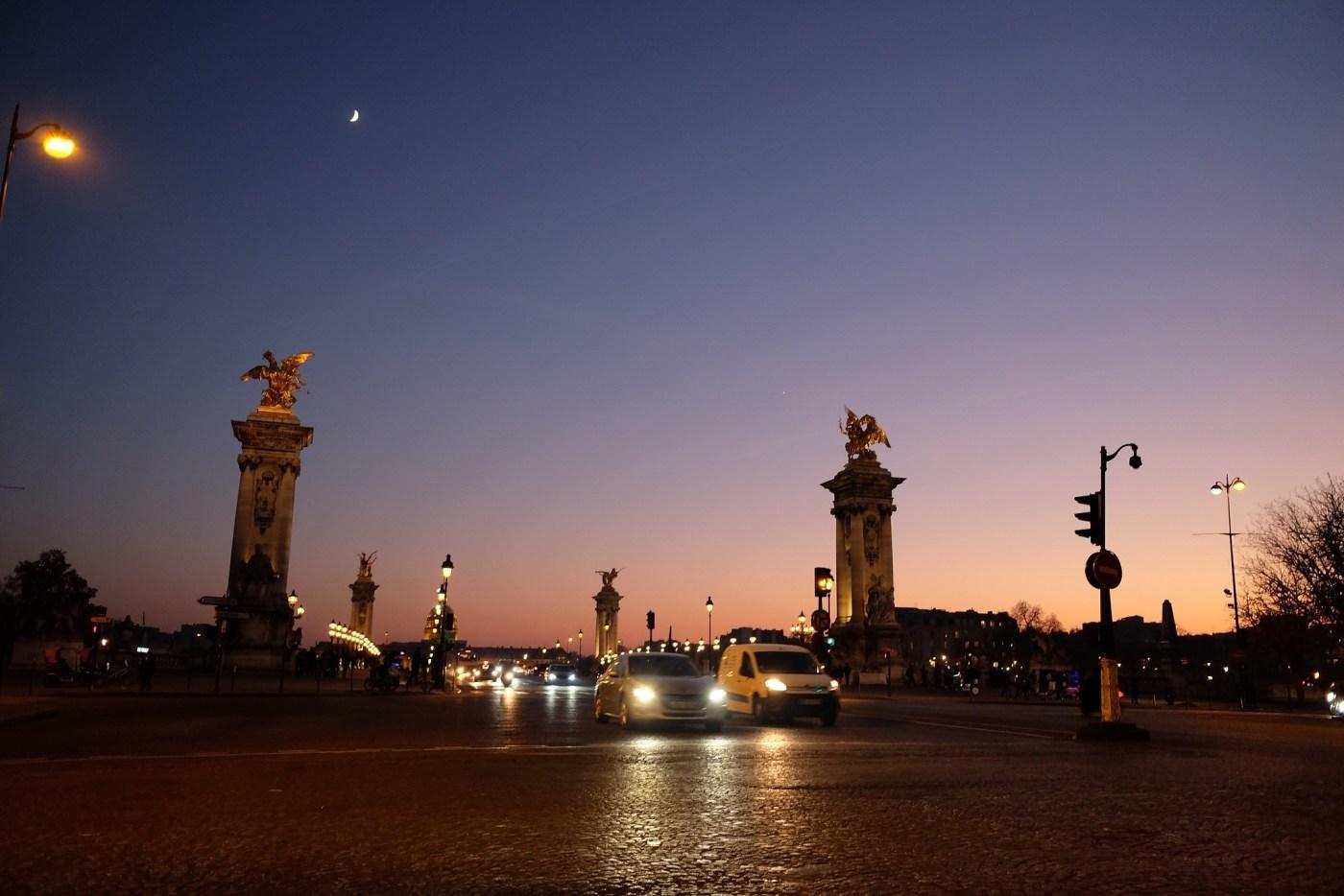 The Pont Alexandre III is a deck arch bridge that crosses the Seine in Paris