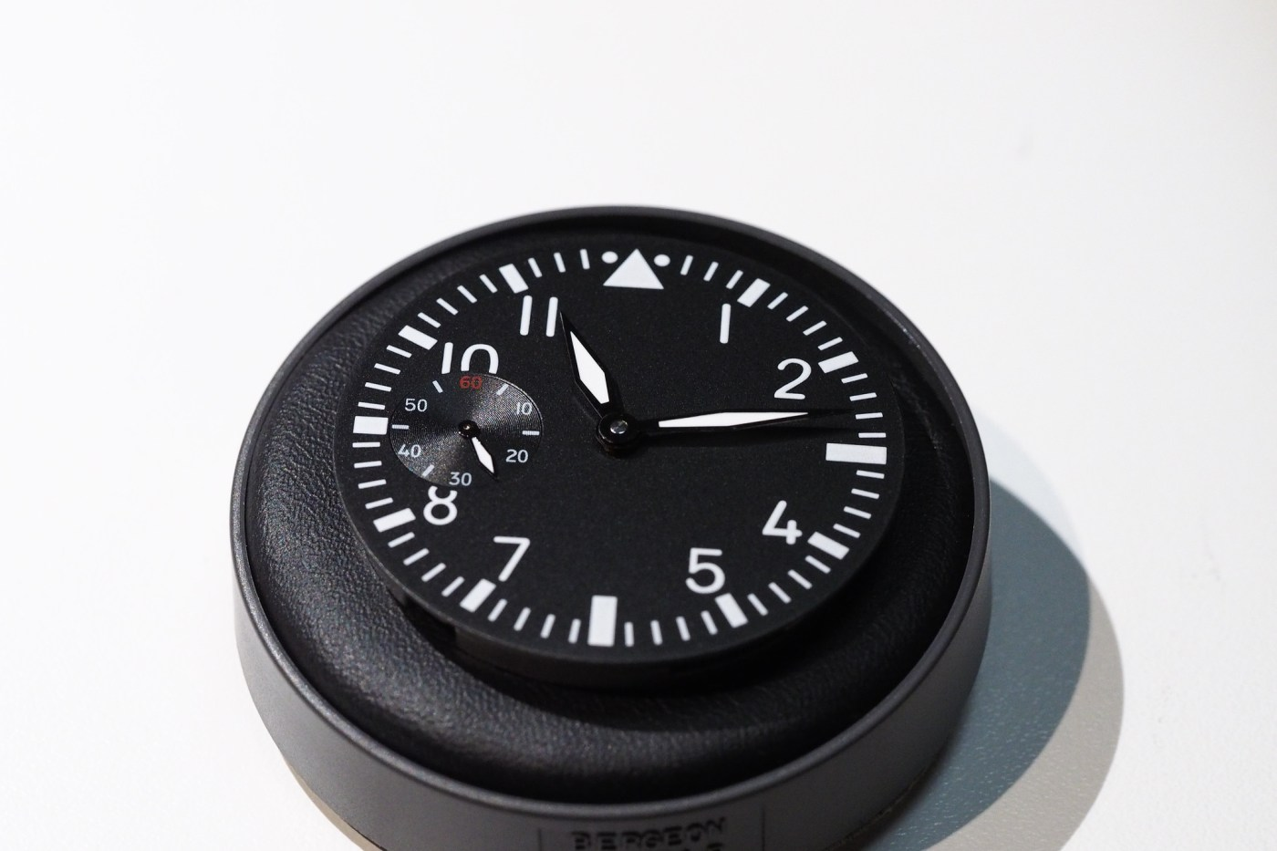 Watch movement and dial on case cushion in preparation to case up