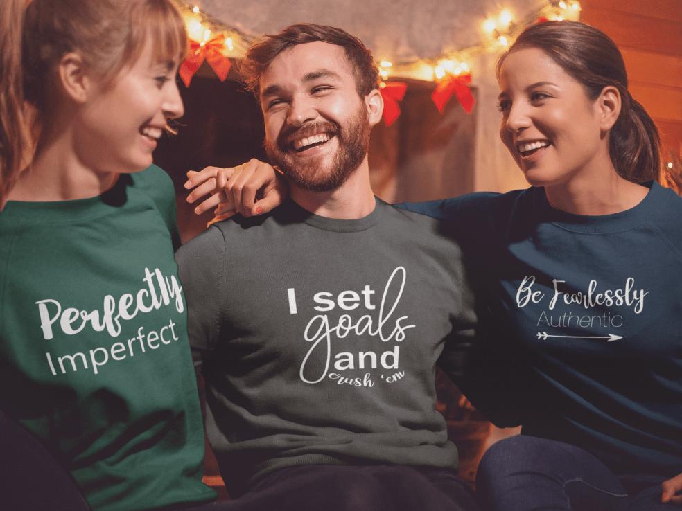 sweatshirt-mockup-of-three-friends-celebrating-christmas-18042