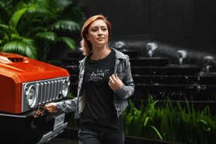 t-shirt-mockup-of-a-young-woman-walking-by-an-all-terrain-truck-412-el(1)