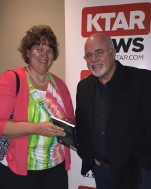 Susan presents a copy of her book to Dave Ramsey, the man whose advice has helped thousands of business owners.