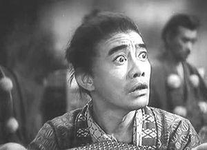Japanese actor Kenichi Enomoto as porter in Th...