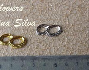 Aliança em plastico dourada ou prateada 2,5x1cm
