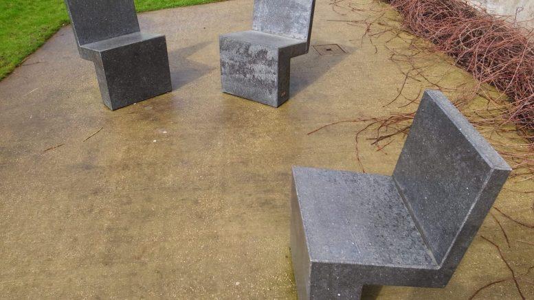 Three empty concrete seats