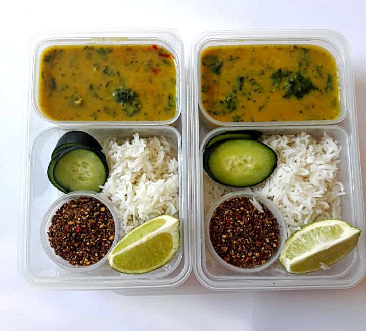 Spinach Lentil Curry with Rice in a lunch box container