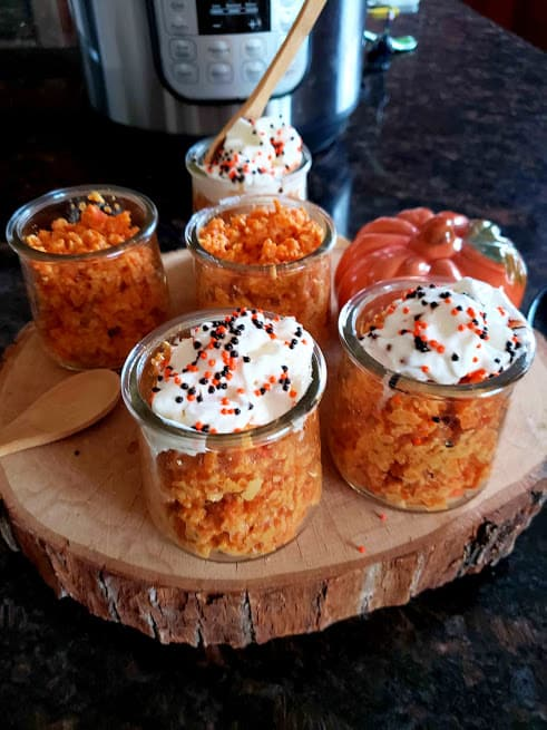 Instantpot Gajar Halwa served in mason jars with whipped cream and halloween sprinkles on top.