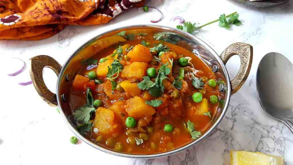 Aloo Matar in Copper Pot on Marble top