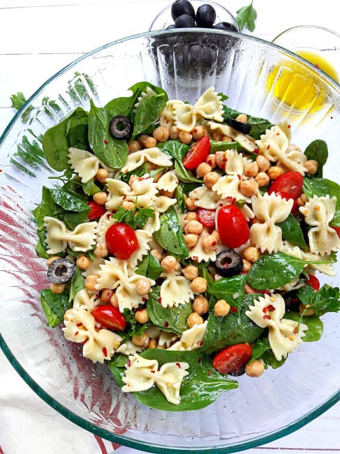 Bow Tie Pasta, Spinach, olives and tomatoes, chickpeas marinated in lemony greek vinaigrette