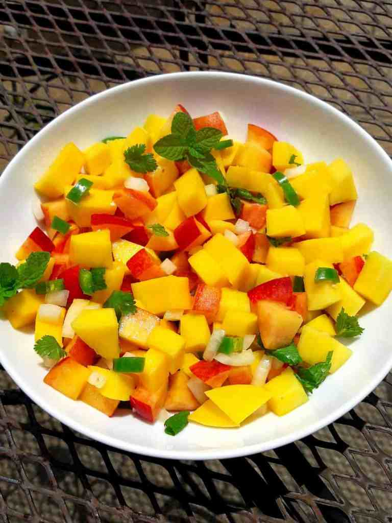 Mango Peach Salsa with onions, jalapeno peppers and cilantro , mint lime seasoning