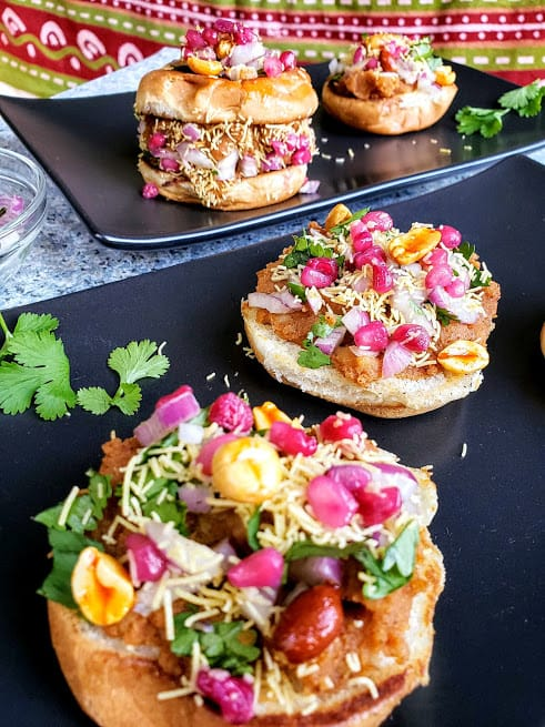 Dabeli is delicious and famous Indian street food. These spicy and tangy sliders are perfect party appetizers or snack.  Learn how to make dabeli at home with step by step detail instructions. #profusioncurry #indianstreetfood #indiansnack #dabeli