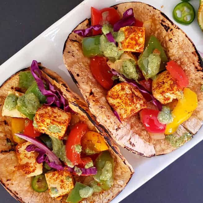Paneer Tacos are delicious mexican fusion dinner tacos. It combines ever popular paneer tikka with the tacos. Easy delicious recipe is perfect for unique weeknight dinner or for party and potlucks.