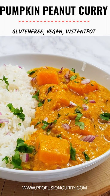 Creamy spicy Thai Pumpkin peanut curry served over white rice for dinner.