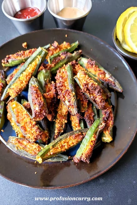 Stuffed Okra or Bharwa Bhindi is a popular Indian side dish easy to make in airfryer or on the stove. Okra is stuffed with spicy and  tangy masala filling to make this low calorie, vegan and gluten free recipe. #airfryer #profusioncurry