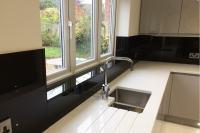 Jet Black Glass Splashback & Window Sill in Modern Kitchen