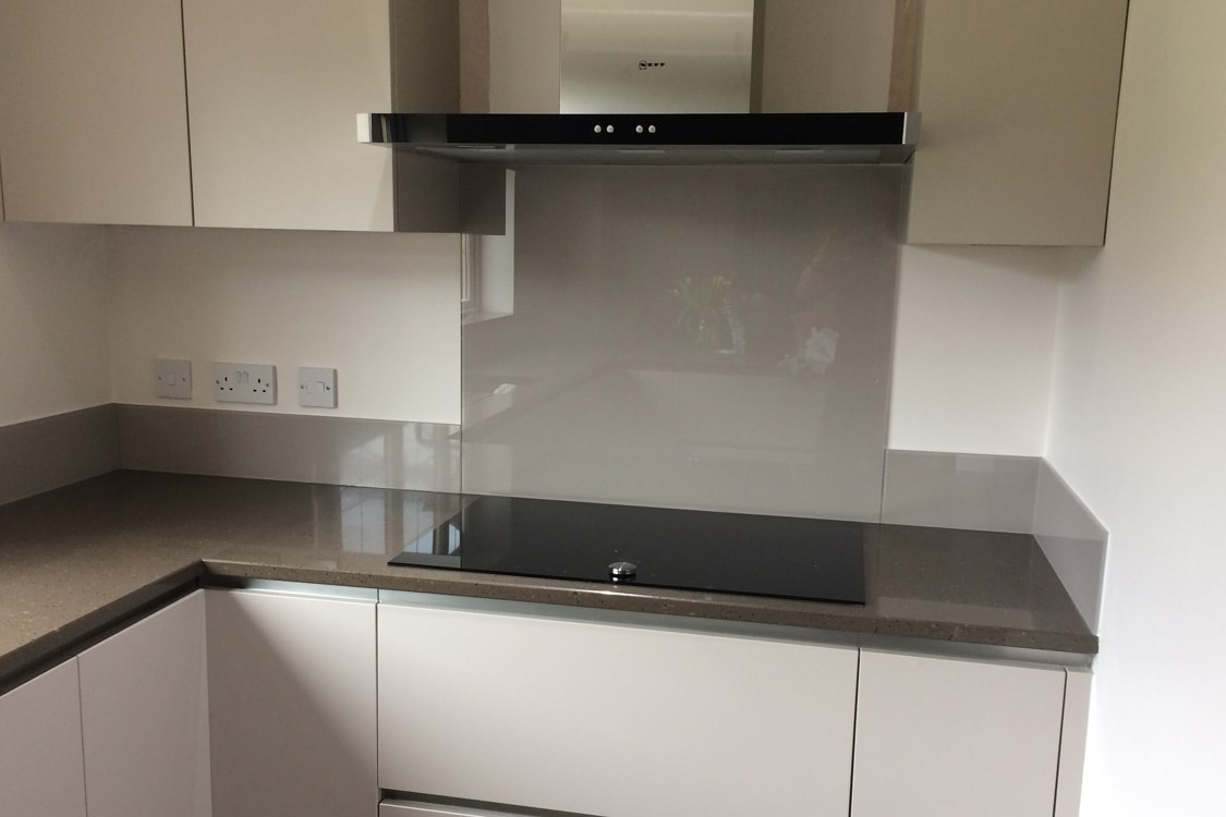 Glass Splashback Fitted in Modern Kitchen Coloured in