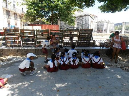 A group of schoolchildren gather in a plaza in Old Havana. (Photo: Nancy Trejos, USA TODAY)