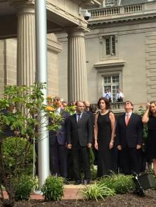 The Cuban flag being raised at the Washington embassy. From left to right (in black dress) Under Secretary of State Roberta Jacobson, Cuban Foreign Minister Bruno Rodriguez, and Josefina Vidal, head of the Cuban Foreign Ministry's North American affairs division.
